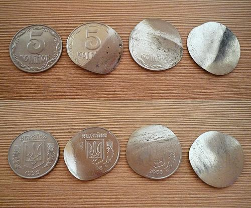 Понівечені монетки